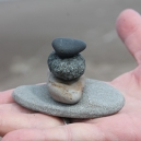 rocks stacked on open palm